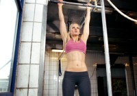 Massage Athletica - Girl doing pull-ups